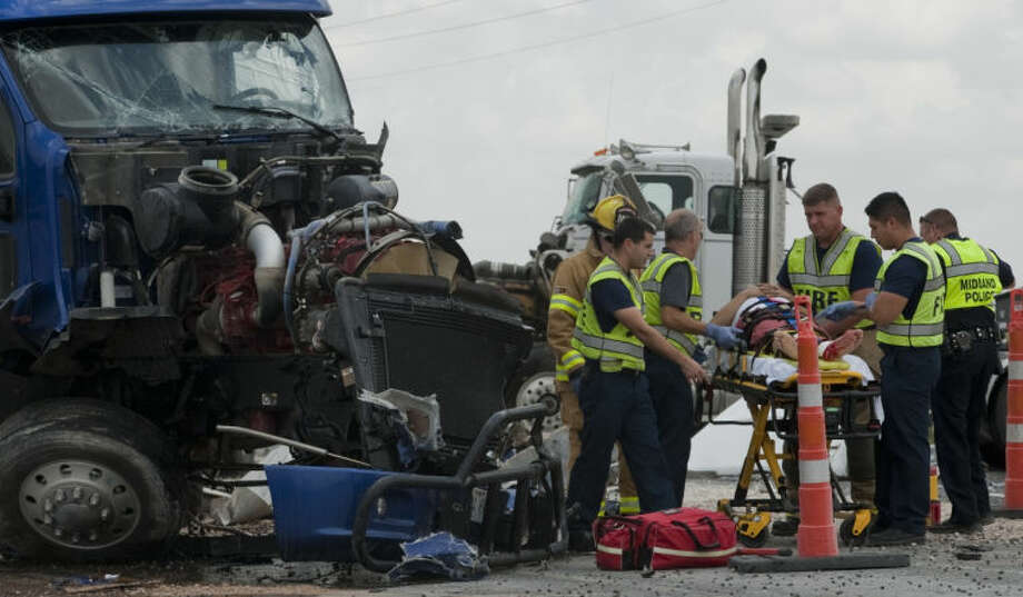 One driver was transported to MMH with unknown injuries following a two tractor-trailer accident Thursday afternoon on Hwy 349 and Craddick Hwy. The driver of the other truck was not injured. Tim Fischer\Reporter-Telegram Photo: Tim Fischer