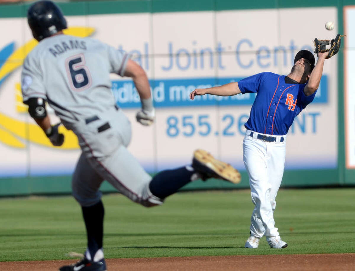 Rockhounds Conner Crumbliss catches a fly ball from Northwest Arkansas' Lane Adams (running in foreground) last Friday at Security Bank Ballpark. Midland faced Northwest Arkansas once again Wednesday, and it resulted in another loss. James Durbin/Reporter-Telegram