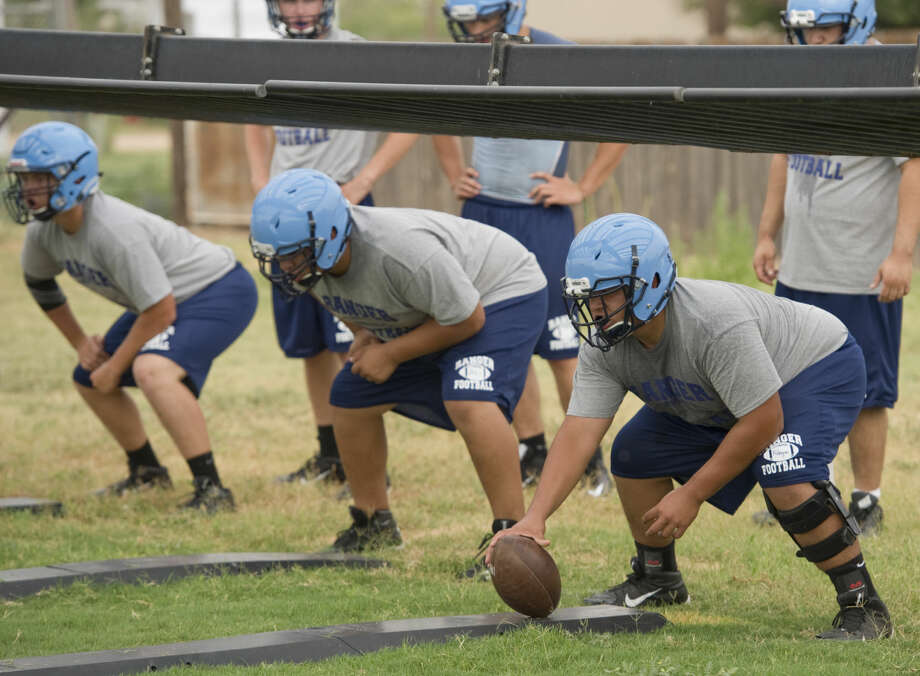 Greenwood center Jesus Rodriguez and other offensive lineman run drills Monday 8-3-15, during the first day of practice for 2015-2016 season. Tim Fischer\Reporter-Telegram Photo: Tim Fischer