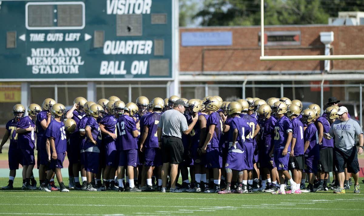 Midland High football team at the first practice of the season Monday, August 10, 2015 at Memorial Stadium. James Durbin/Reporter-Telegram