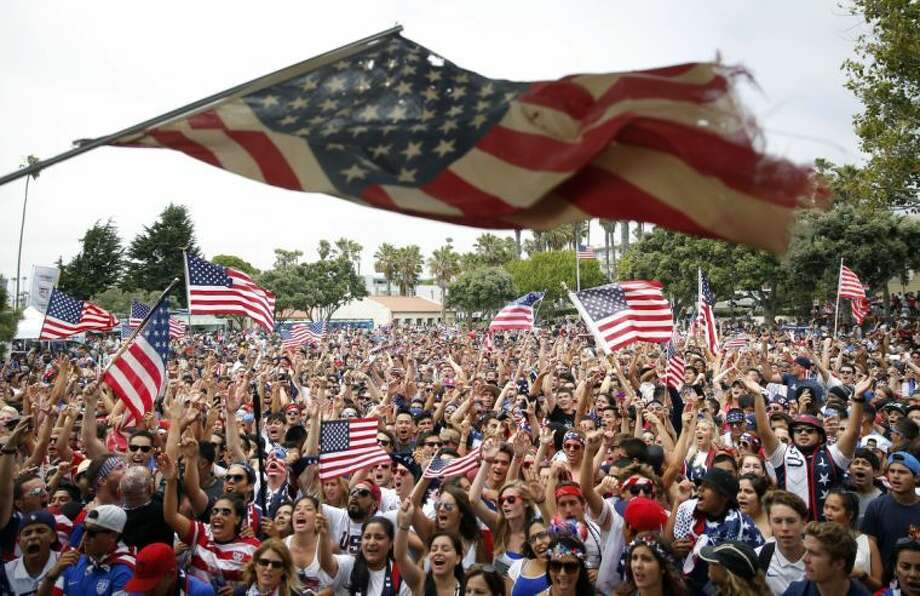 United States fans cheer while watching the World Cup soccer match between the U.S. and Belgium at a viewing party on Tuesday, July 1, 2014, in Redondo Beach, Calif. Belgium won 2-1 in extra time. (AP Photo/Jae C. Hong) Photo: Jae C. Hong