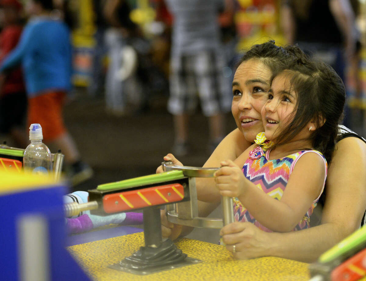 Susie Diaz and 4-year-old Zaida play a game at the Midland County Fair on Saturday, August 22, 2015 at Horseshoe Arena. James Durbin/Reporter-Telegram