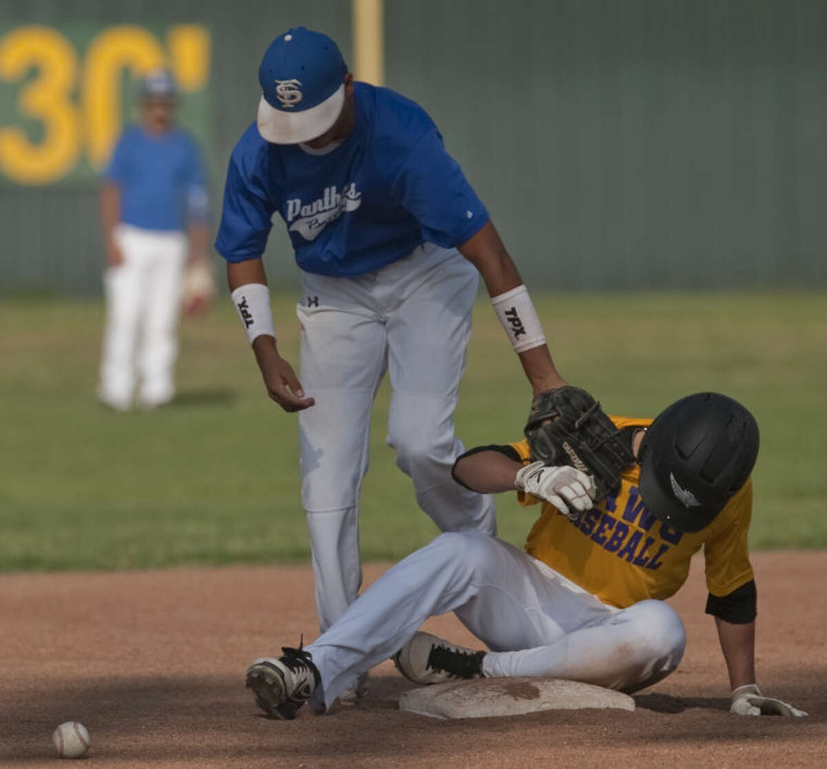 Midland's Josh Raies is safe for a double as Fort Stockton's Jay Castro drops the ball Monday in a Connie Mack Baseball game. Tim Fischer\Reporter-Telegram