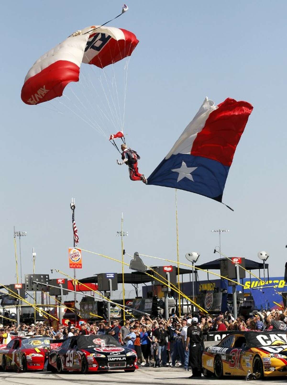 The Re/Max Skydiving Team kicked off the Salute Our Troops Pre-Race Show at Texas Motor Speedway prior to the start of the NASCAR Sprint Cup Series AAA Texas 500 Sunday at Texas Motor Speedway. James Durbin/Reporter-Telegram