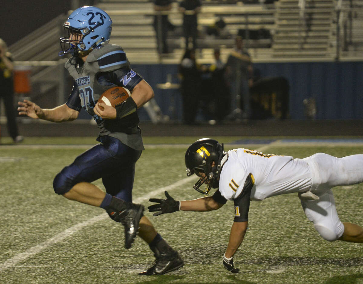 Greenwood's Jake Rogers gets past the reach of Seminole's Ransom Edwards for a touchdown Friday 8-28-2015 at J.M. King Memorial Stadium in Greenwood. Tim Fischer\Reporter-Telegram
