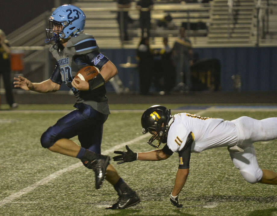 Greenwood's Jake Rogers gets past the reach of Seminole's Ransom Edwards for a touchdown Friday 8-28-2015 at J.M. King Memorial Stadium in Greenwood. Tim Fischer\Reporter-Telegram Photo: Tim Fischer