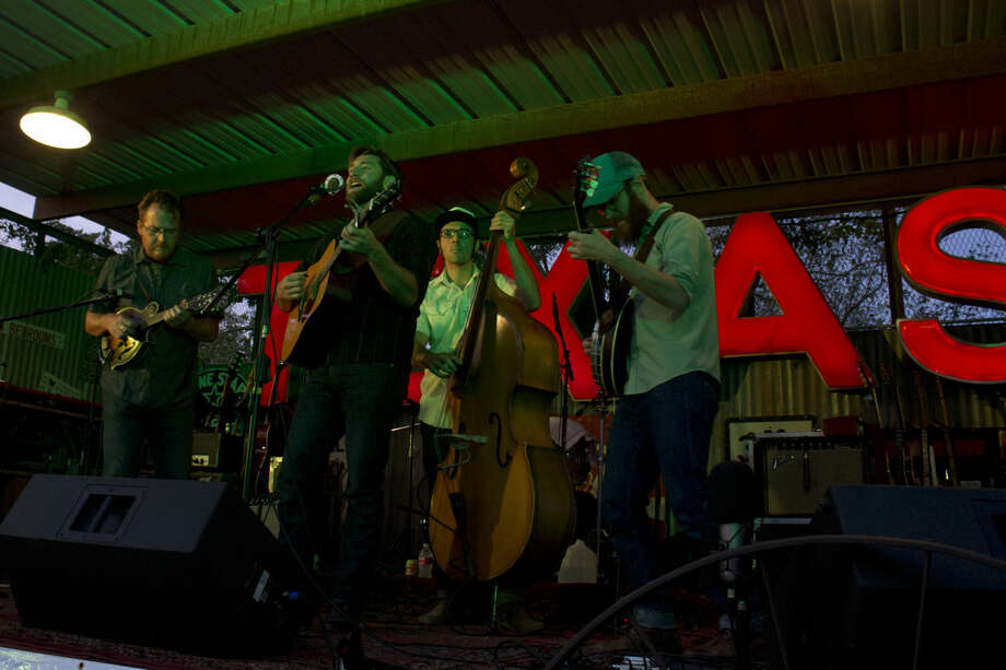 Bluegrass band Wood & Wire was the first act to get the crowd on its feet. With their blend of multiple stringed instruments and southern-twang vocals, people were forced to shake off their recently devoured meat on the dance floor. Trent Johnson/ Reporter-Telegram Photo: Trent Johnson