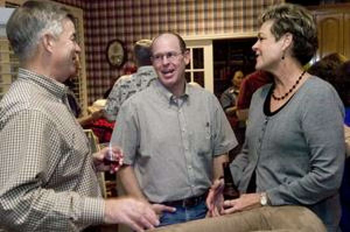 Jeff Sparks, center, is congratulated after his election win in 2009. Sparks is one of four councilmen this year not to draw an opponent during the upcoming elections.