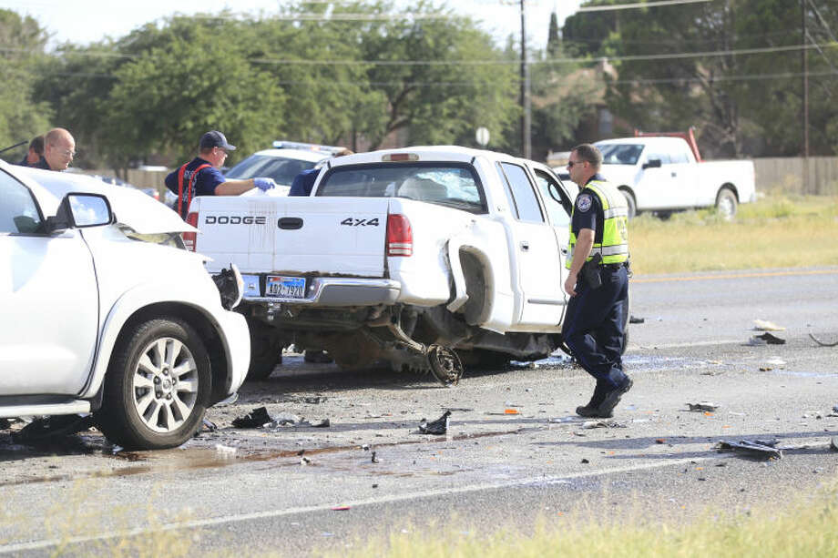 Midland emergency personnel work the scene of a fatal wreck on Loop 250 near the Midkiff onramp. James Durbin/Reporter-Telegram Photo: James Durbin