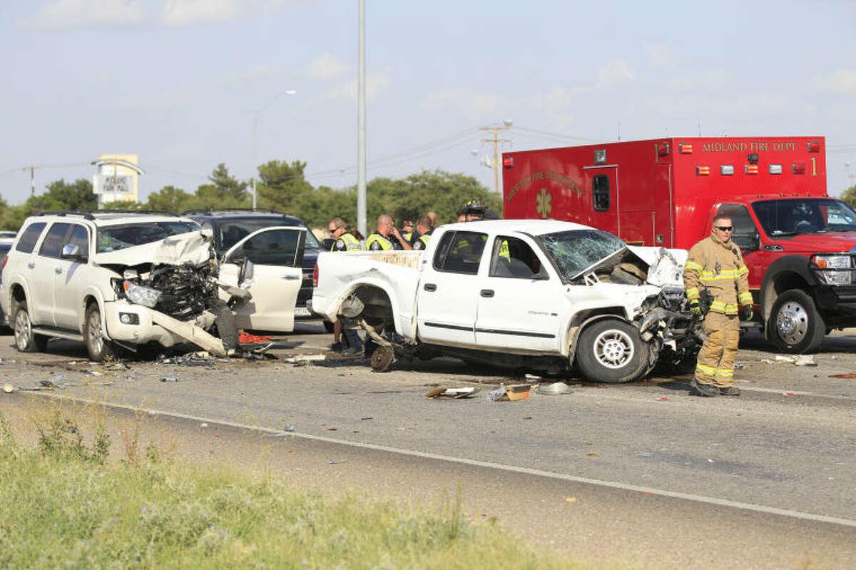 Midland emergency personnel work the scene of a fatal wreck on Loop 250 near the Midkiff onramp. James Durbin/Reporter-Telegram
