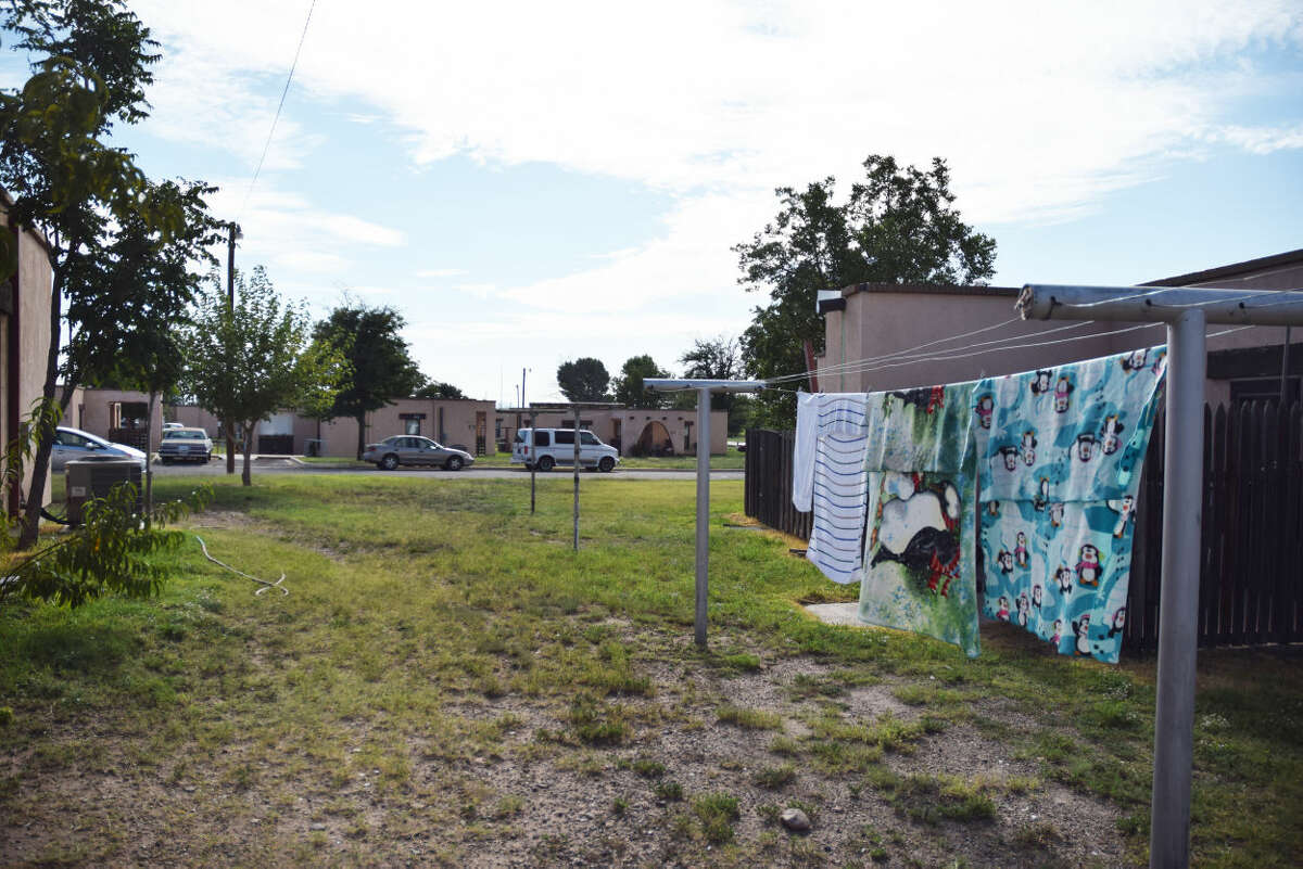 Clothes hang out to dry at the Marfa Housing Authority's main complex. An increase in artists moving into the area and tourism has pushed both home values and rent up, forcing many low income individuals into difficult situations.