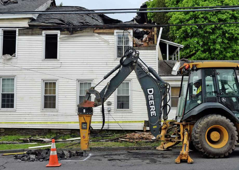 Crews on the scene of an overnight fire on Third Avenue between 13th and 14th streets Friday May 6, 2016 in Watervliet, NY.  (John Carl D'Annibale / Times Union) Photo: John Carl D'Annibale / 20036510A