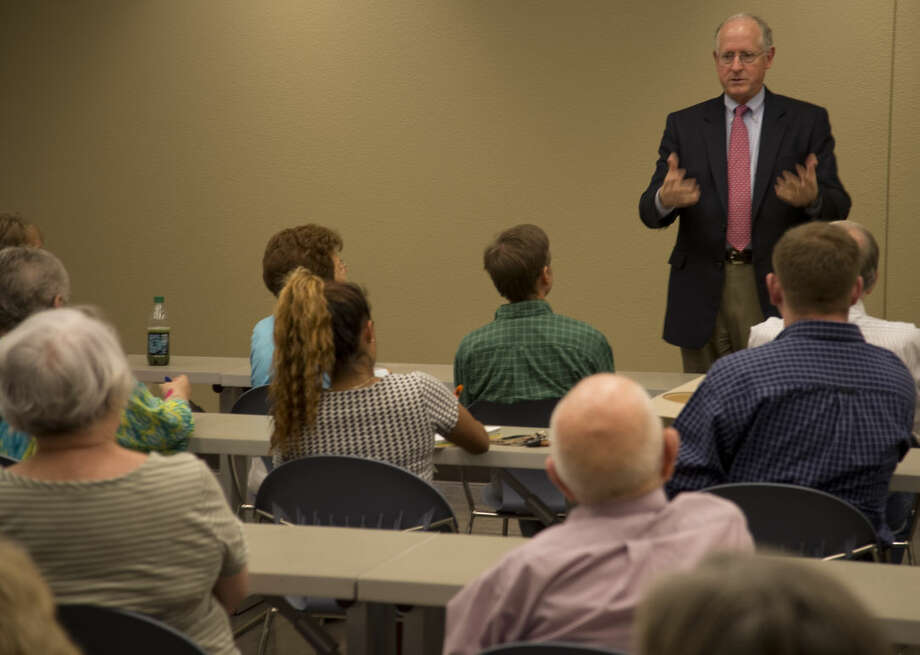 U.S. Representative Mike Conaway addresses a full room Monday 8-31-2015 during a town hall meeting at the Midland Centennial Library. Tim Fischer\Reporter-Telegram Photo: Tim Fischer