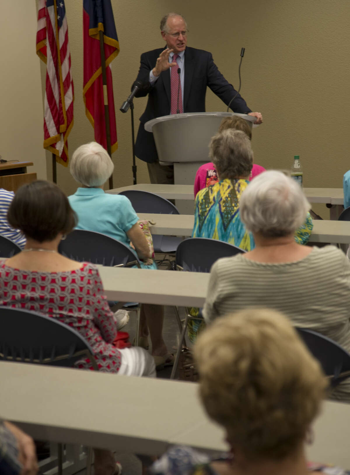 U.S. Representative Mike Conaway addresses a full room Monday 8-31-2015 during a town hall meeting at the Midland Centennial Library. Tim Fischer\Reporter-Telegram