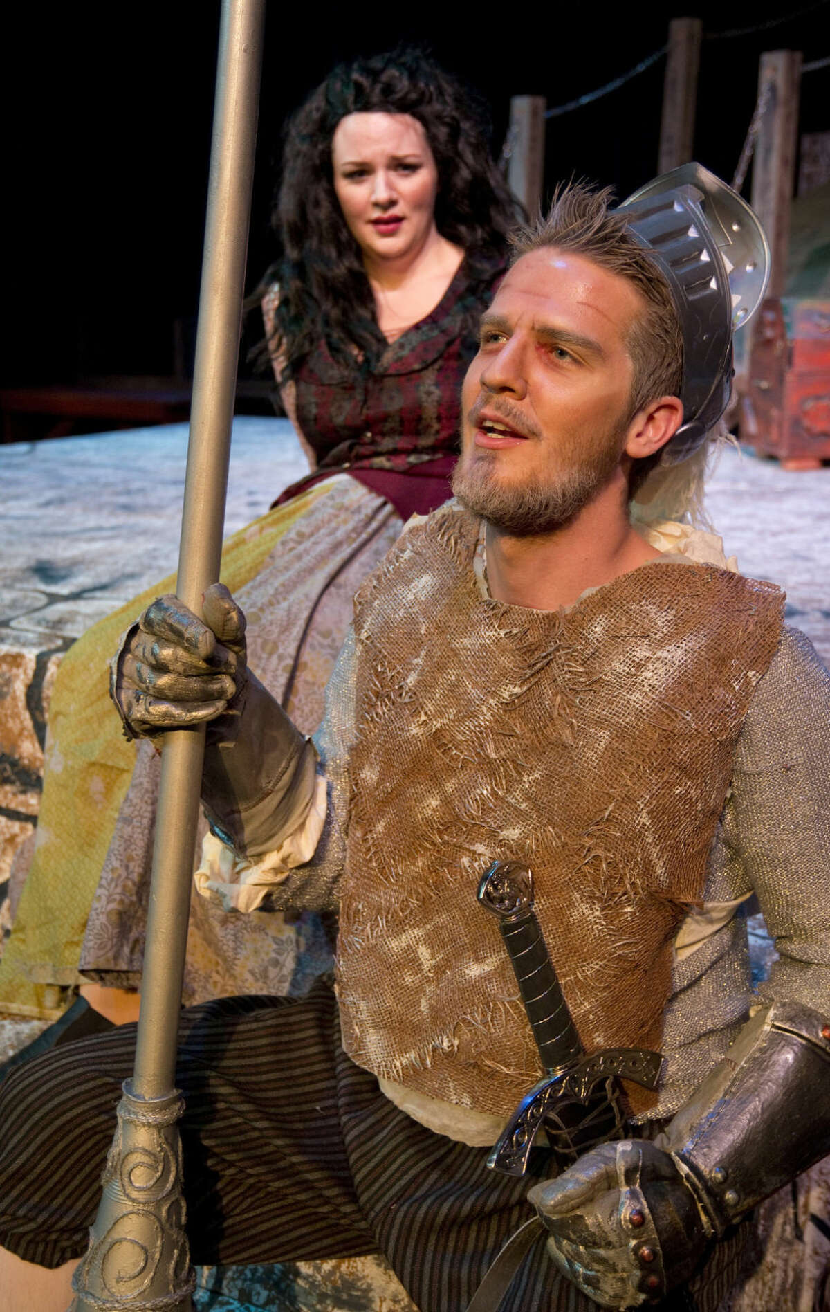 Abby Anderson as Aldonza looks at Drew Henry as Don Quixote in 'Man of La Mancha.'