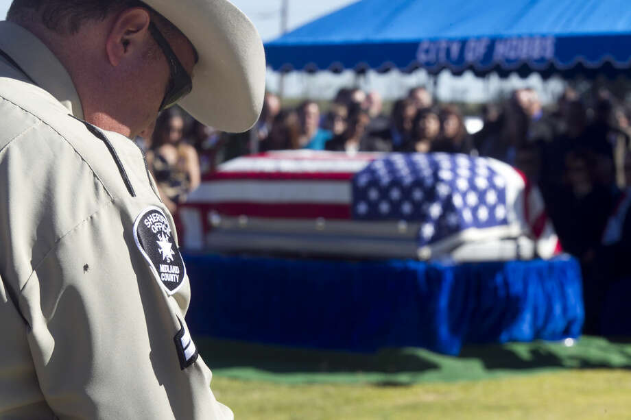Burial ceremony for Midland County Sheriff's Dept. Sgt. Mike Naylor at Prairie Haven Cemetery in Hobbs, New Mexico, last year. James Durbin/Reporter-Telegram Photo: James Durbin
