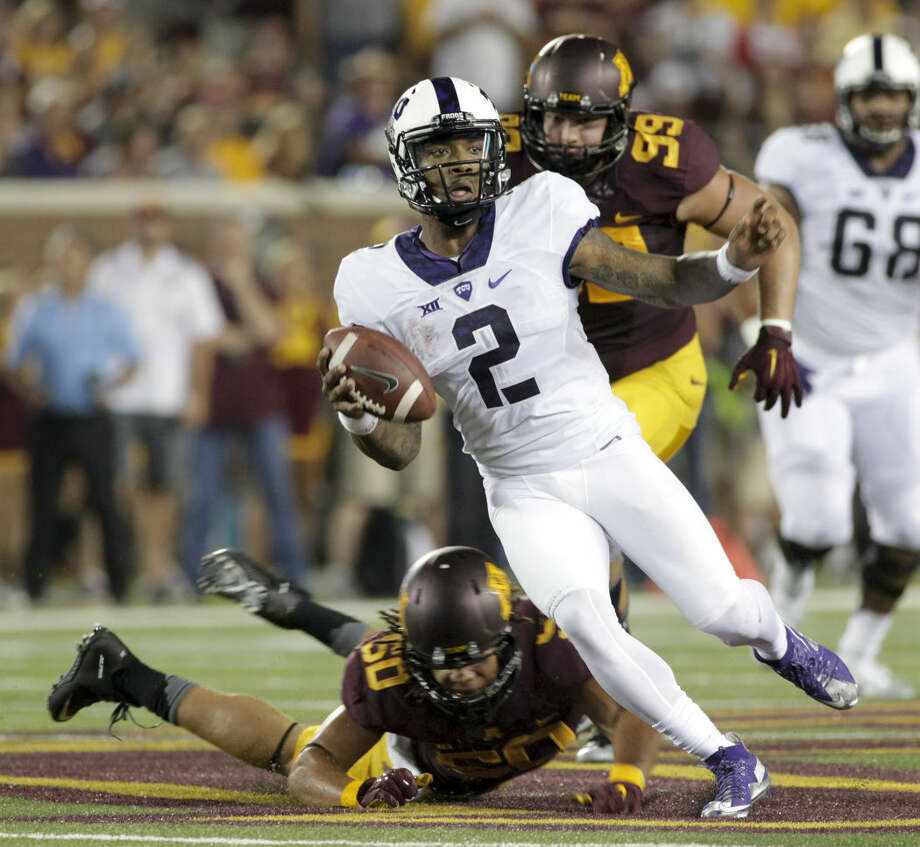 TCU quarterback Trevone Boykin (2) evades the tackle of Minnesota offensive lineman Matt Leidner (60) during the first half of an NCAA college football game Thursday, Sept. 3, 2015, in Minneapolis. AP Photo/Paul Battaglia) Photo: Paul Battaglia