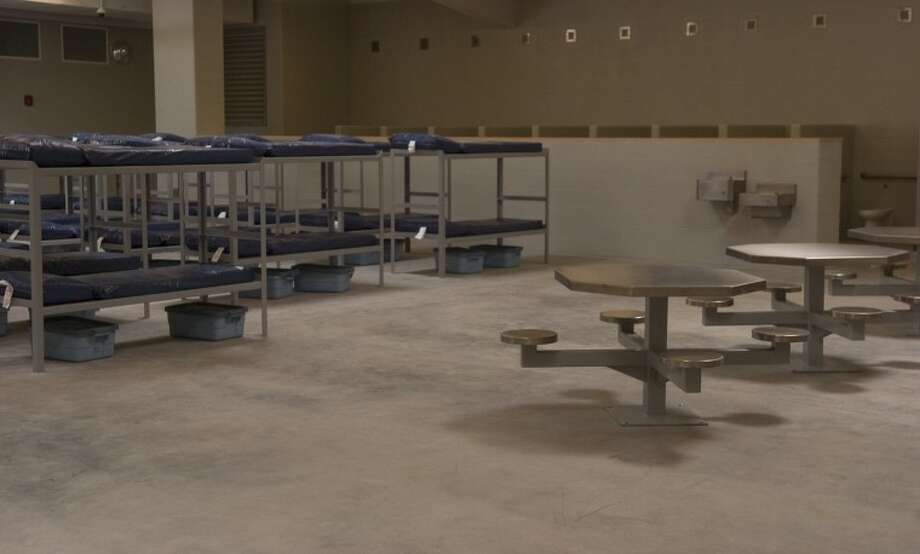One of three cells in the new jail where prisoners will sleep, eat, shower, and remain from any outside contact. Photo by Tim Fischer/Midland Reporter-Telegram Photo: Tim Fischer