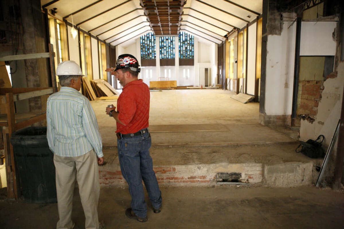 First Presbyterian Church member Pam Hunter, left, talks with Jeremy Olive, director of operations at First Presbyterian, while touring an area under construction Wendesday. James Durbin/Reporter-Telegram