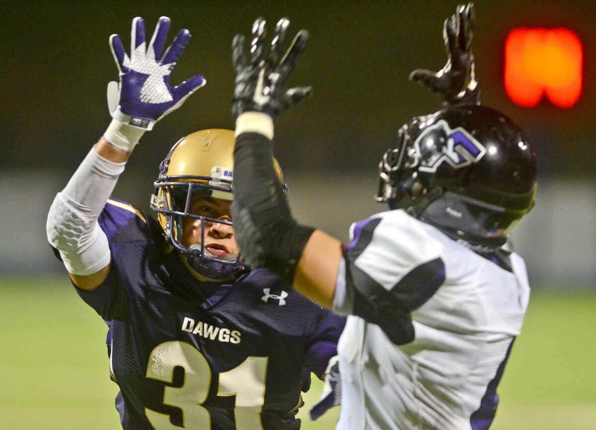 Midland High's Noah Marquez (31) covers El Paso Franklin wide receiver Gustavo Mendoza-Dorset on Friday at Grande Communications Stadium. James Durbin/Reporter-Telegram