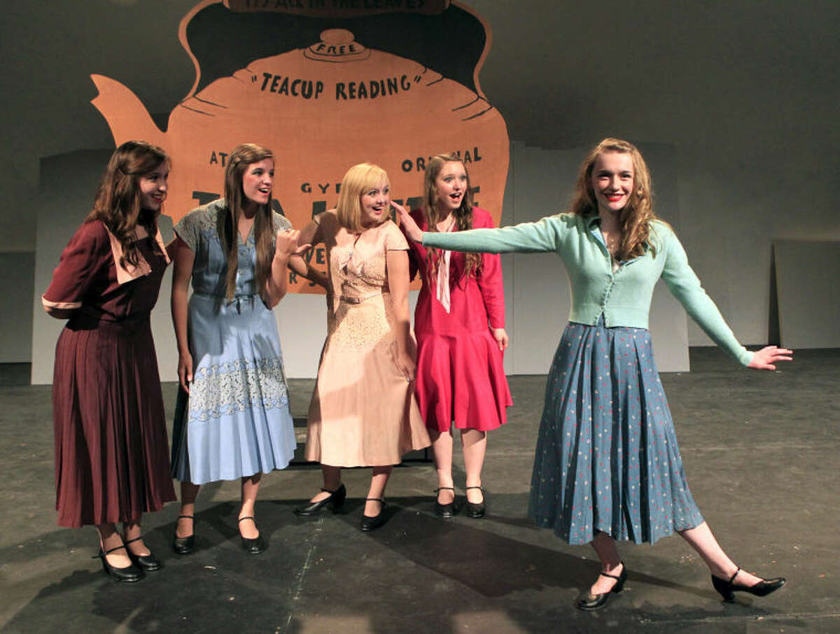 """Lorriane (Samantha Shepherd), Phyllis (Brittany Jennings), Ann (Hope Englestad) and Diane (Sydney Hobbs) watch Peggy (Carly Baker) demonstrate her dance skills during rehearsal for the Midland Community Theatre production """"42nd Street"""" on Tuesday at MCT. James Durbin/Reporter-Telegram"""