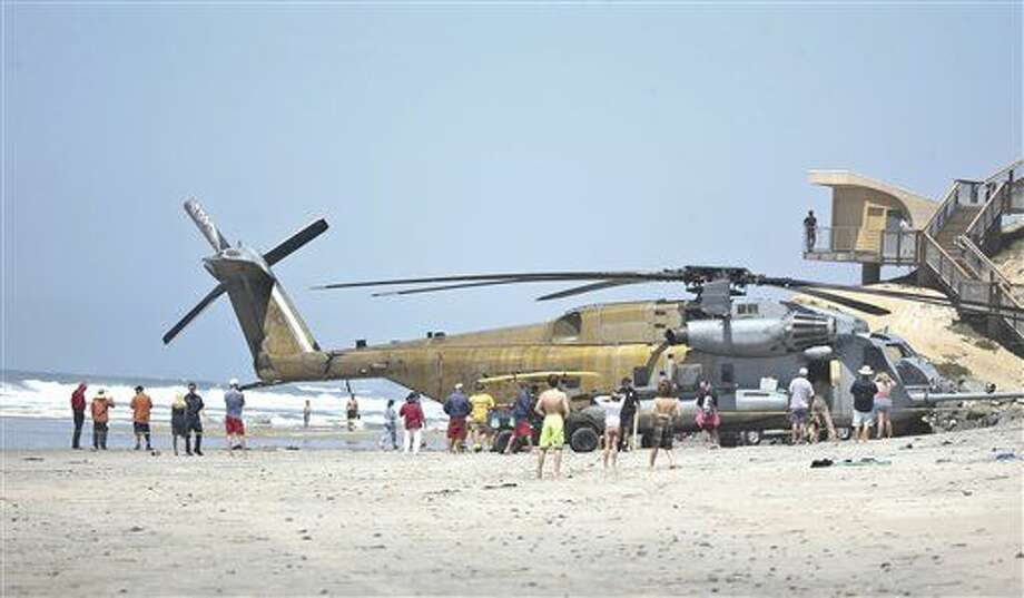 FILE -In this Wednesday, April 15, 2015 file photo, a Marine Corps CH-53E helicopter sits in the sand where it made an emergency landing in Solana Beach, Calif. One Marine has been killed and 9 others were hurt when a helicopter made a hard landing at Camp Lejeune in North Carolina, Wednesday night, Sept. 2, 2015. (AP Photo/Lenny Ignelzi, File) Photo: Associated Press