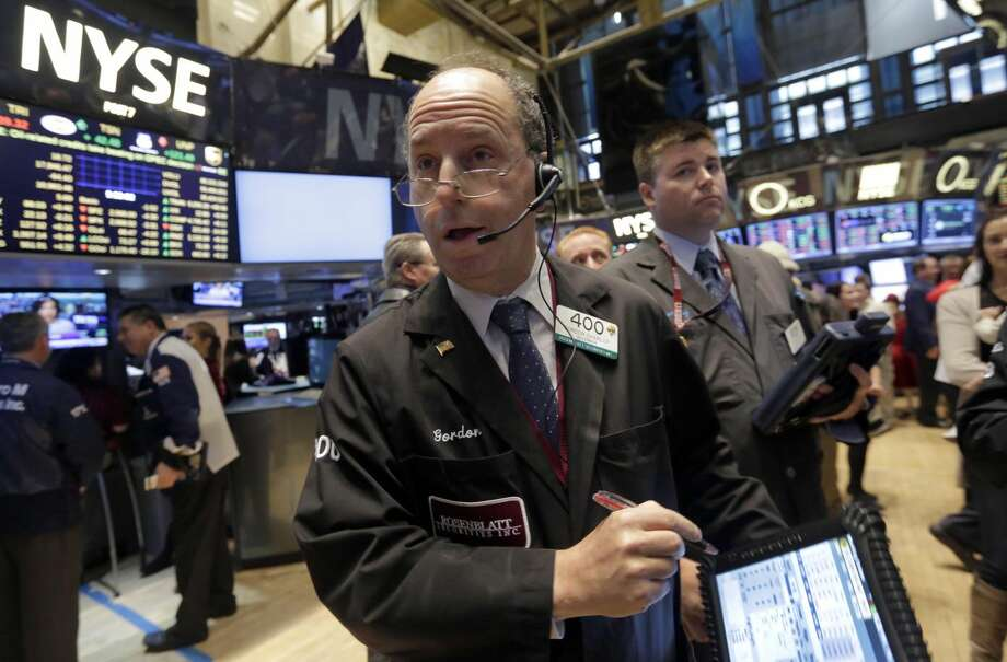 Trader Gordon Charlop, center, works on the floor of the New York Stock Exchange last year. Photo: Richard Drew
