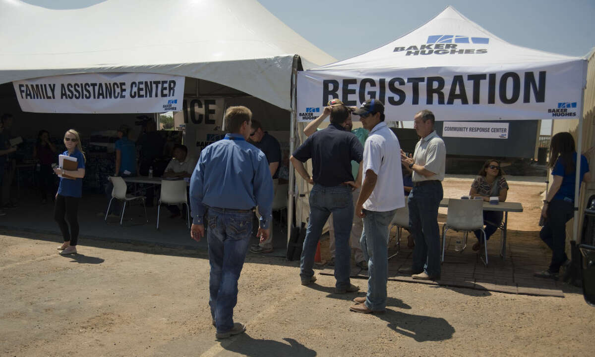 Baker Hughes has set up tents Tuesday 9-1-2015 behind Solid Rock Fellowship Church off I-20 for residents to get information, bottled water and water purifiers if they live in they effected area. Tim Fischer\Reporter-Telegram
