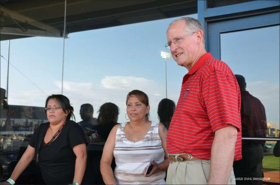 U.S. Rep. Mike Conaway visits with Sylvia Macias, center, mother of Spc. Robert Arsiaga.