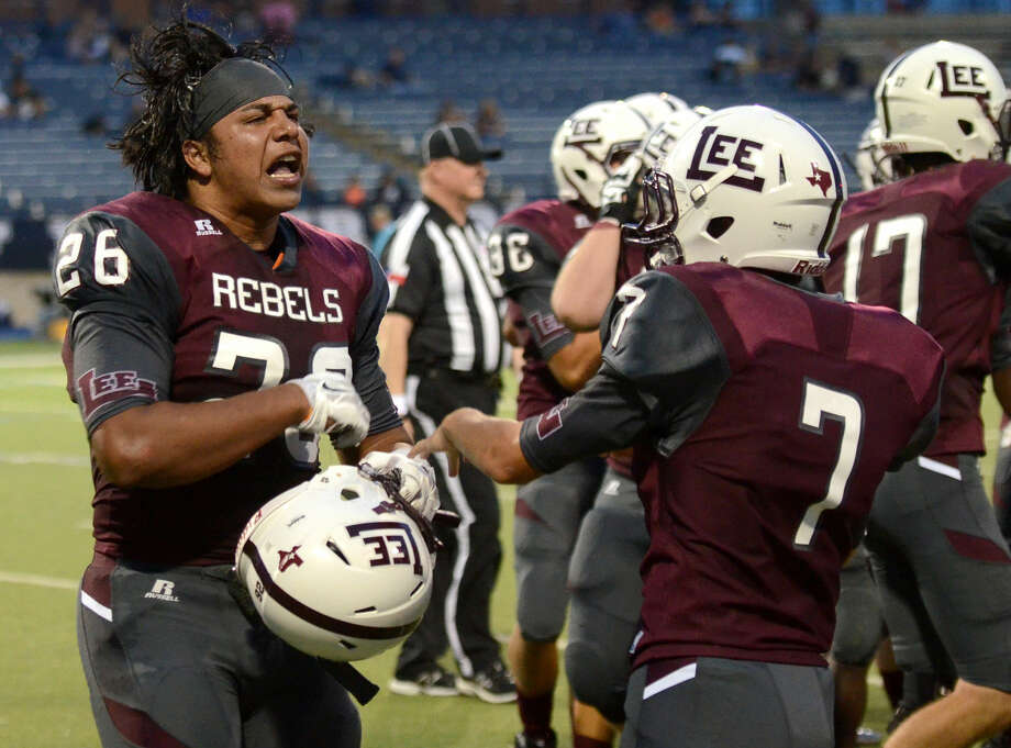 Lee High defensive lineman Kaleb Nunez (26) celebrates after recovering a fumble to bring about a change of possession against Smithson Valley on Friday, Aug. 28, 2015 at Grande Communications Stadium. James Durbin/Reporter-Telegram Photo: James Durbin