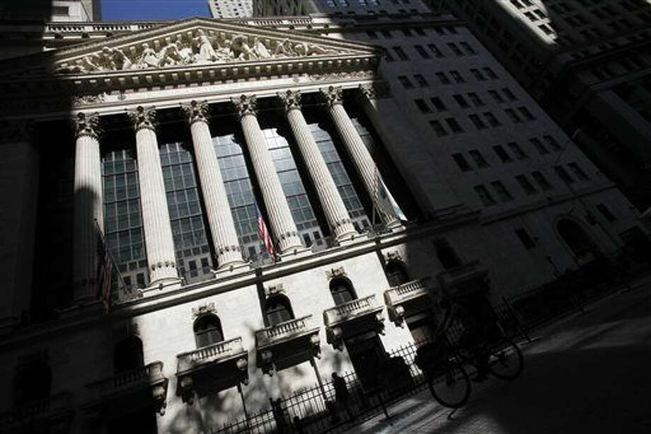 FILE - This July 15, 2013 file photo shows the New York Stock Exchange in New York. Global stock markets fell sharply Friday, Sept. 4, 2015, ahead of the release of monthly U.S. jobs figures that could well determine whether the Federal Reserve will raise interest rates later this month, a prospect that's unnerving investors at a time when markets have been so volatile. (AP Photo/Mark Lennihan, File) Photo: Mark Lennihan