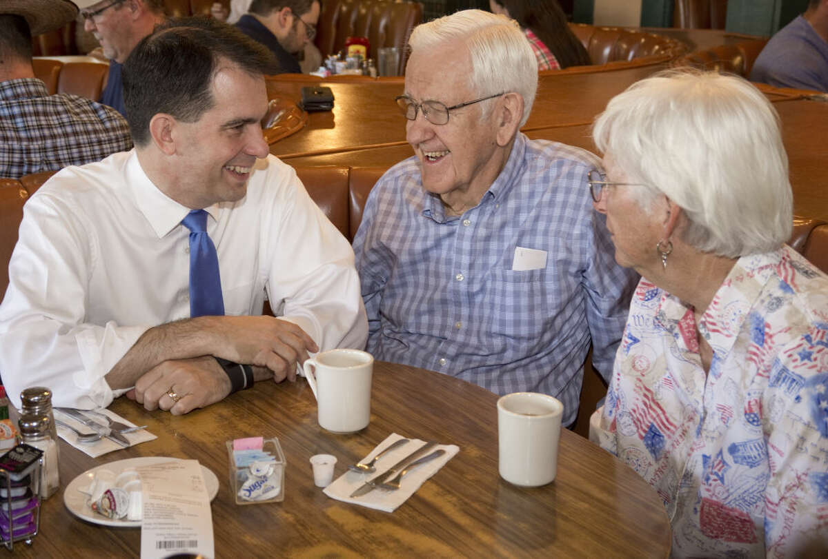 Presidential candidate Scott Walker sits to talk with Fariss Murphy from Odessa and Zaro Foster from Midland as well as other patrons at Lori's Cafe Friday 9-4-2015 morning in Midland. Tim Fischer\Reporter-Telegram