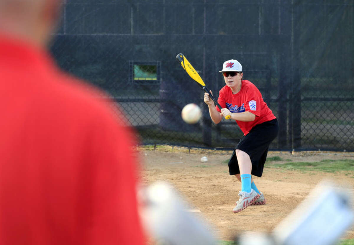 Bryce Lewis, a member of Midland's Little League Intermediate Team All-Stars, practices bunting on Monday at Mid Cities. James Durbin/Reporter-Telegram