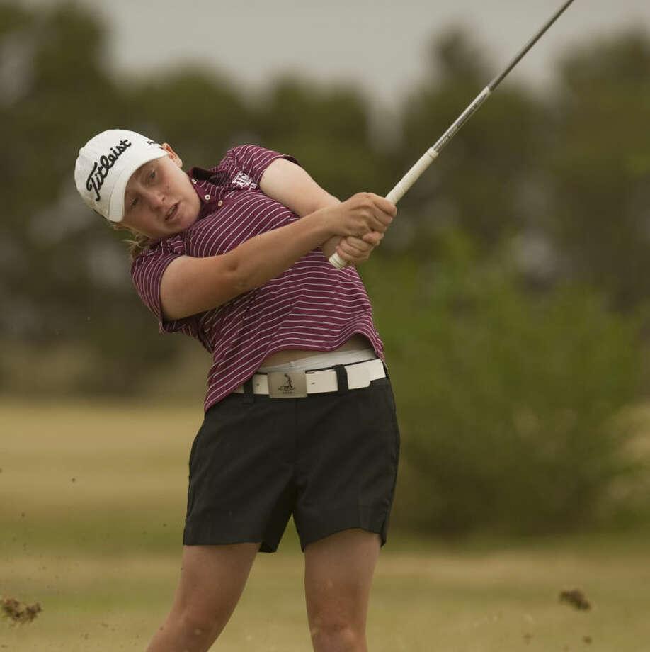 Rebecca Reed blasts a shot toward the green Tuesday at Ranchland Hills Golf Club during the Women's City Tournament. Tim Fischer\Reporter-Telegram Photo: Tim Fischer