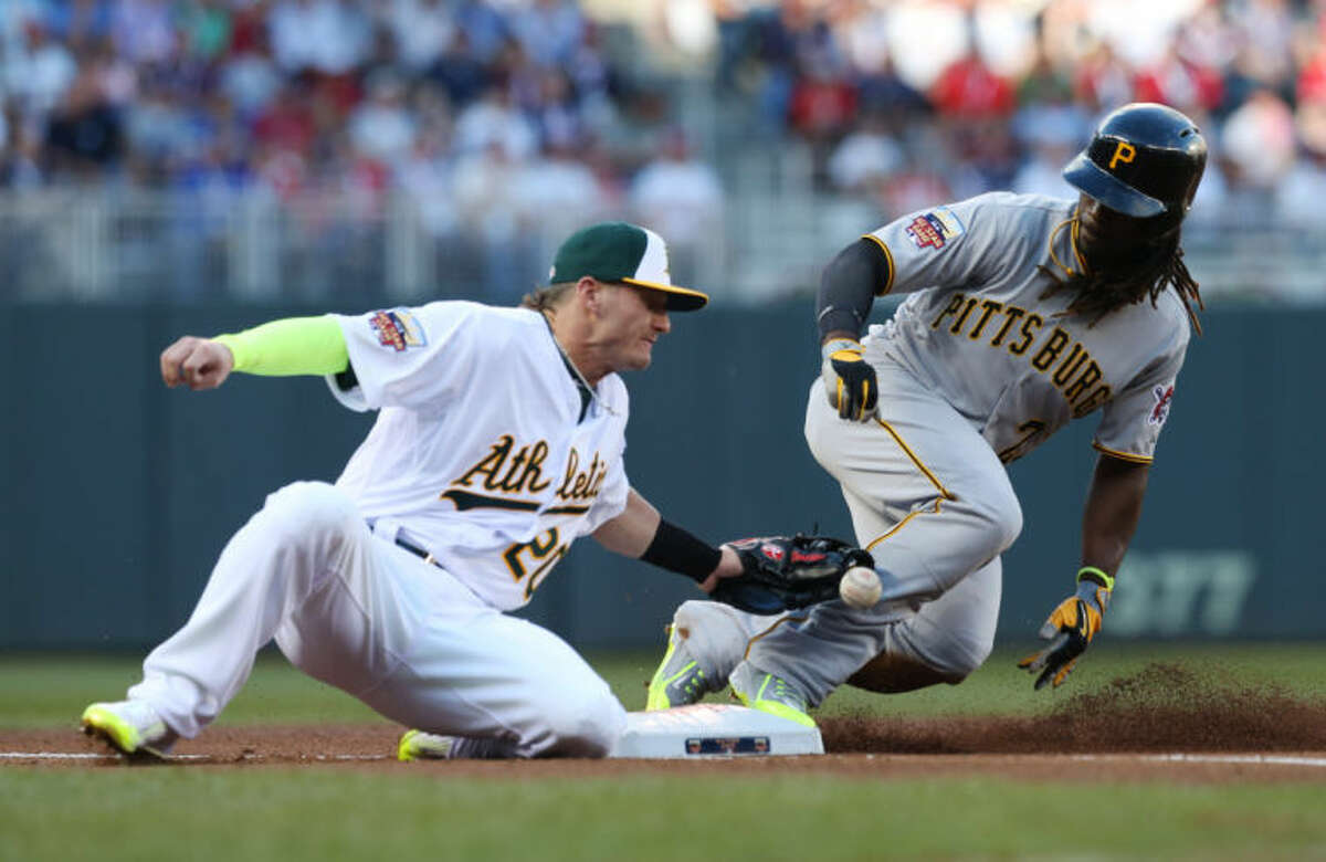 National League outfielder Andrew McCutchen, of the Pittsburgh Pirates, steals third base as American League Josh Donaldson, of the Oakland Athletics, tries to make the tag during the first inning of the MLB All-Star baseball game, Tuesday in Minneapolis. (AP Photo/Jim Mone)