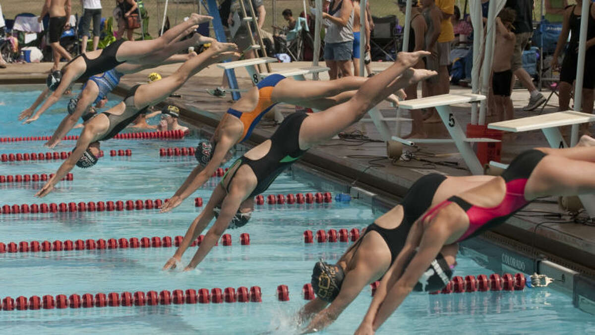 (File Photo) Swimmers take the start for the 50m freestyle Friday at the Frost Bank Invite at Doug Russell Pool. Tim Fischer\Reporter-Telegram