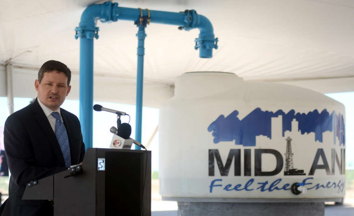 Jay Edwards speaks during the T-Bar ribbon cutting ceremony Friday at the elevated storage tank near 191 and 1788. James Durbin/Reporter-Telegram