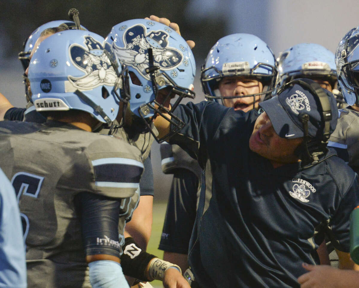 Greenwood coach Shad Hanna encourages his team during a timeout in a game against Brownfield at J.M. King Memorial Stadium on Friday. Tim Fischer\Reporter-Telegram