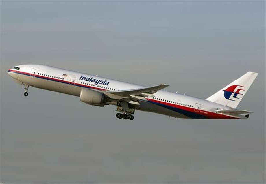 In this Nov. 15, 2012 photo, the Malaysia Airlines Boeing 777-200 with tail number 9M-MRD _ the same aircraft that was shot down near the Ukraine Russia border on Thursday, July 17, 2014 _ takes off from Los Angeles International Airport. Ukraine said the passenger plane was shot down Thursday as it flew over the country, and both the government and the pro-Russia separatists fighting in the region denied any responsibility for downing the plane. (AP Photo/JoePriesAviation.net) Photo: JoePriesAviation.net / AP