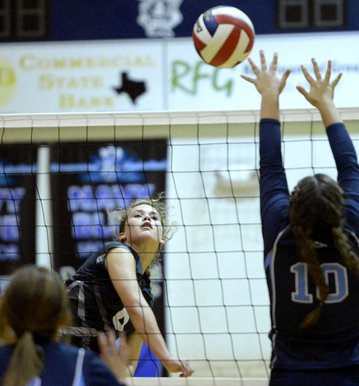 Trinity's Mady Walker (6) hits past Greenwood's Payslee Sims (10) and Kyndall Dove (13) on Tuesday, Sept. 8, 2015, at Greenwood High. James Durbin/Reporter-Telegram