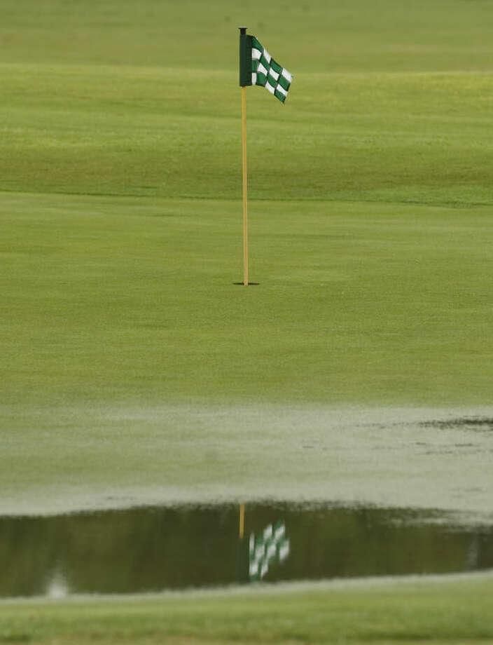 Rain puddles on the putting green at Greentree Country Club Thursday morning. Passing thunderstorms with lightening delayed the Women's City Golf tournament and scattered showers dampened the course and players. Tim Fischer\Reporter-Telegram Photo: Tim Fischer