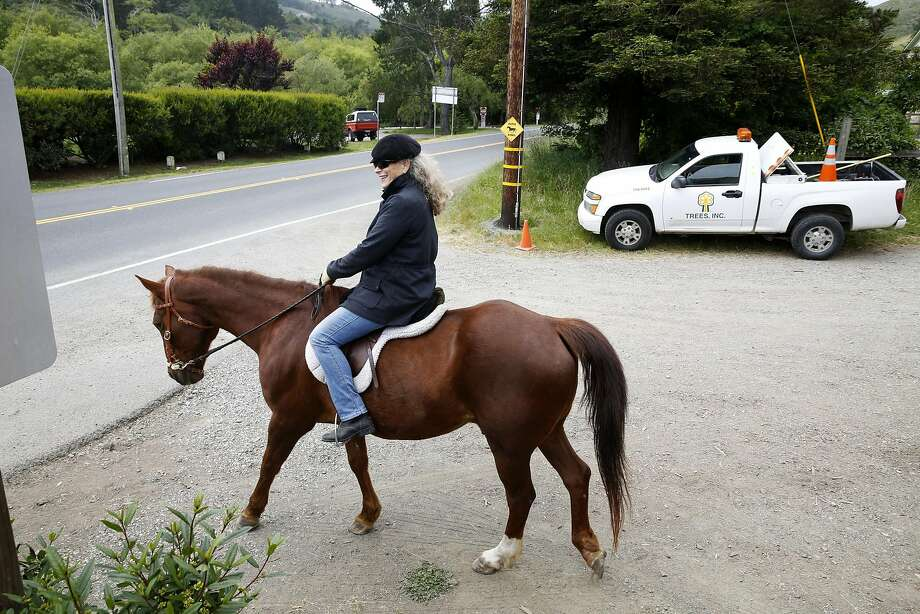 """Thea Chalmers prepares to cross the Shoreline Highway from Golden Gate Dairy stables on her way up Dias Ridge Trail to what riders call the """"top of the world"""" and a beautiful view of S.F. Photo: Connor Radnovich, The Chronicle"""