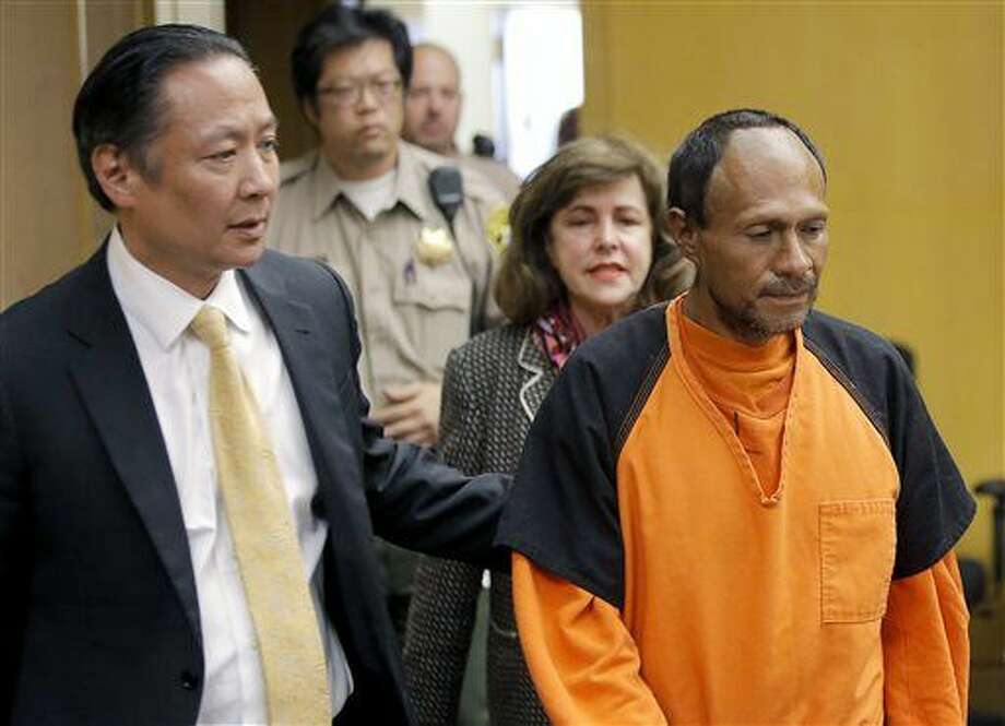 """FILE - In this July 7, 2015 file photo, Juan Francisco Lopez-Sanchez, right, is lead into the courtroom by San Francisco Public Defender Jeff Adachi, left, and Assistant District Attorney Diana Garciaor, center, for his arraignment at the Hall of Justice in San Francisco. The parents of Kathryn Steinle filed a wrongful death claim Tuesday, Sept. 1, 2015 alleging that the San Francisco Sheriff's Department is to blame for releasing an illegal immigrant from jail despite a federal """"detainer"""" request to keep in custody for possible deportation proceedings. A claim is usually a precursor to a lawsuit. (Michael Macor/San Francisco Chronicle via AP, Pool, File) Photo: Michael Macor"""
