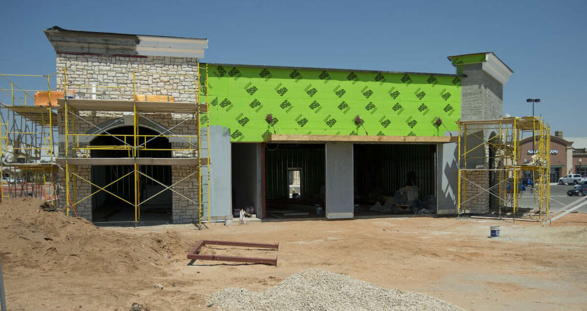 Construction continues on the building Thursday 8-27-2015 at The Commons where 5 Guys Burgers and Fries will open. Tim Fischer\Reporter-Telegram