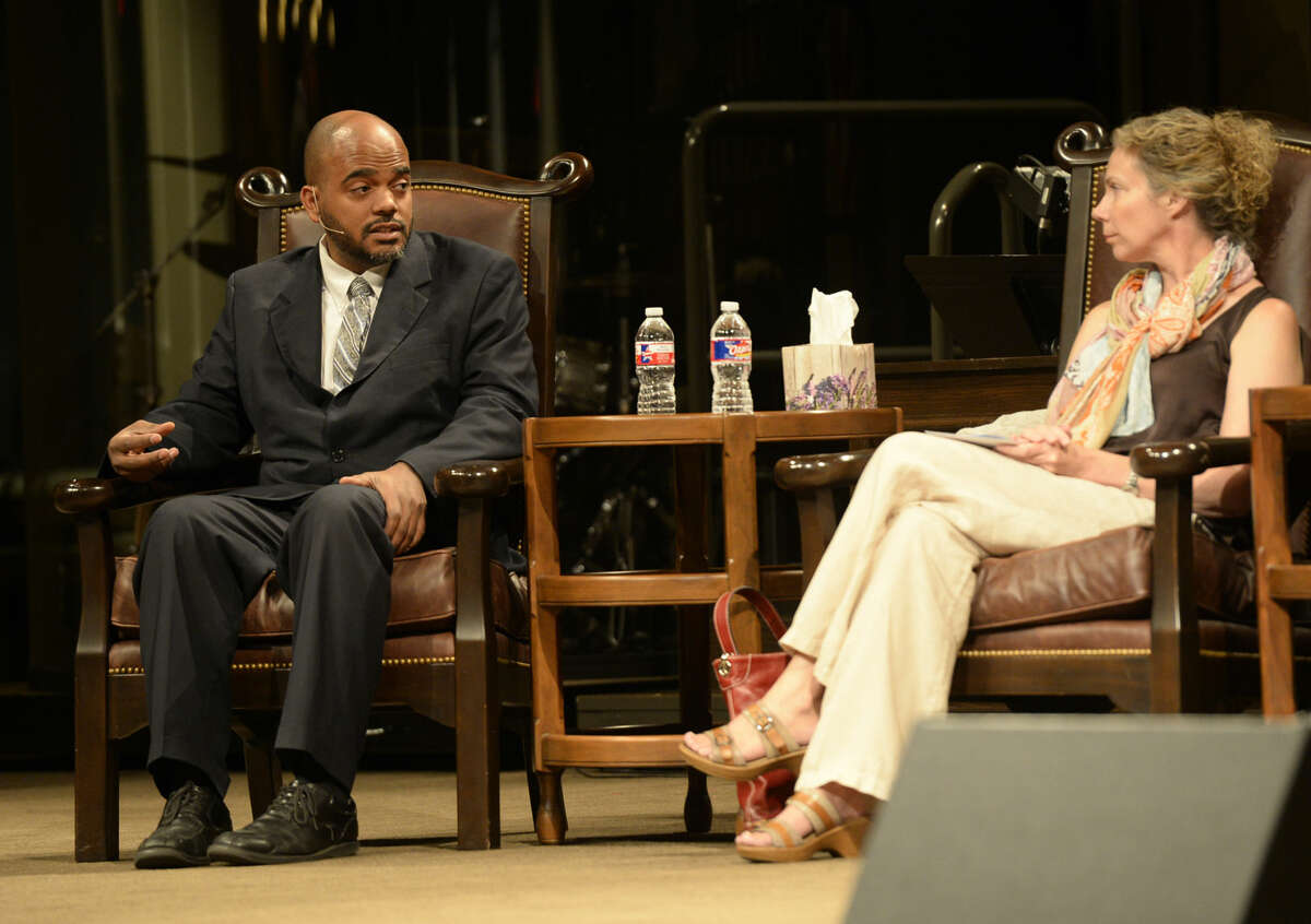 Imam Wazir Ali (left) and Rev. Kathryn Boren (right), take turns answering questions during the annual Interfaith Event on Thursday, Sept. 10, 2015, at First Baptist Church in Midland.