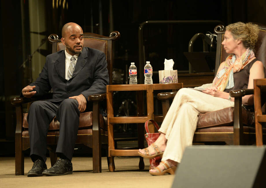 Imam Wazir Ali (left) and Rev. Kathryn Boren (right), take turns answering questions during the annual Interfaith Event on Thursday, Sept. 10, 2015, at First Baptist Church in Midland. Photo: James Durbin