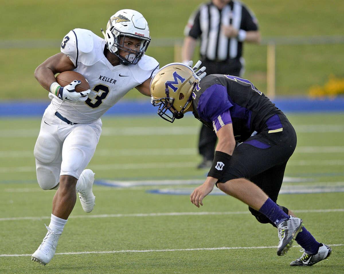 Midland High safety Holt Wood (17) tries to stop Keller running back Tyler Tutt (3) on Thursday, August 27, 2015, at Grande Communications Stadium. James Durbin/Reporter-Telegram