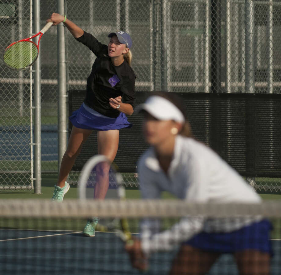 Midland High's Kate Daugherty, black jacket, and Allison Stewart, white jacket, play for the girls doubles championship Friday, 4-10-15, at Bush Tennis Center during the district 3-6A tournament. Tim Fischer\Reporter-Telegram Photo: Tim Fischer