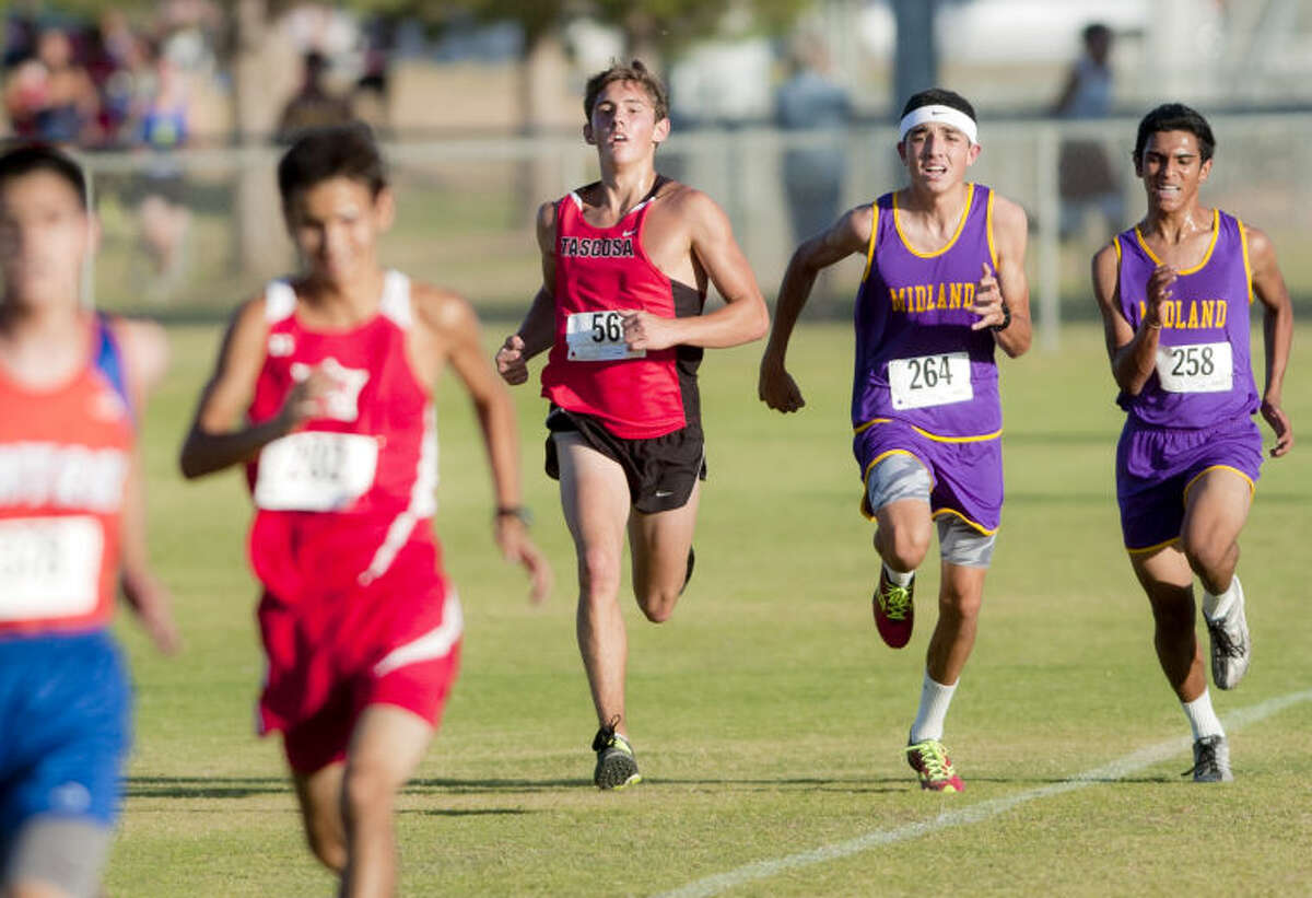 Midland High's Bryce Hoppel and Jose Chavez push to the finish during the Odessa Invitational on Thursday at UTPB park in Odessa. James Durbin/Reporter-Telegram