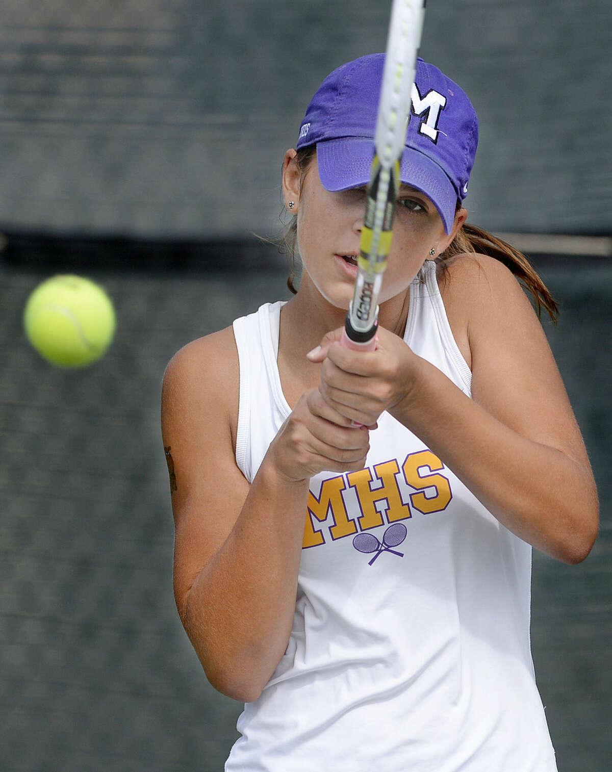 Midland High's Allison Stewart competes in the District 3-6A tennis match against Abilene High on Saturday, Sept. 12, 2015 at the Midland High Tennis Center. James Durbin/Reporter-Telegram